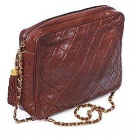 30: Chanel, a brown quilted leather clutch shape handb