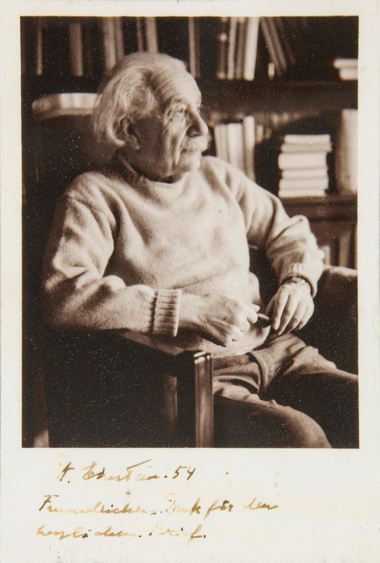 SP A black and white postcard of Albert Einstein seated