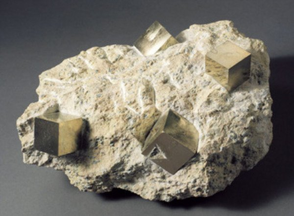112A: A COLLECTION OF PYRITE CUBES IN MATRIX