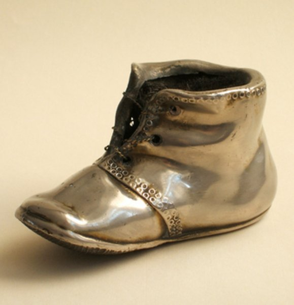 13C: A SILVER PLATED BABY'S BOOTEE PENWIPE, 19th centur