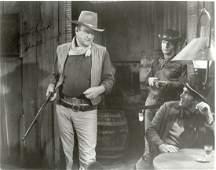 Wayne, John - Black and white movie still photograph of