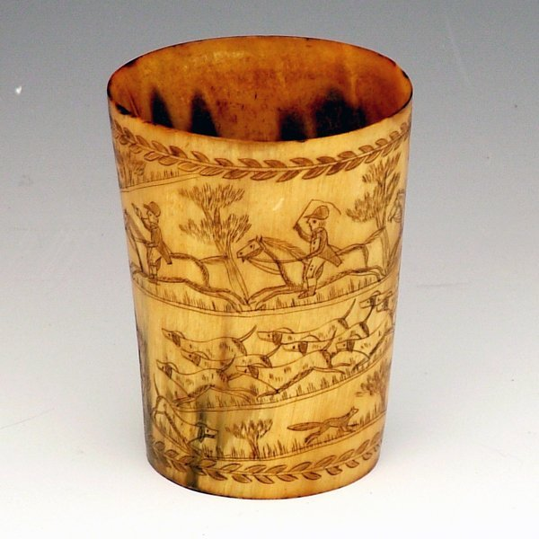 350: Horn beaker engraved with a spiralling scene of a