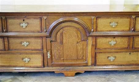 611: Massive oak dresser base or sideboard banded in ma