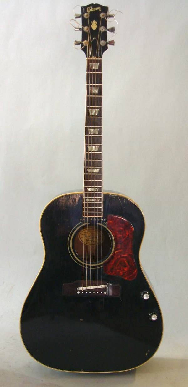 460: Gibson acoustic with case