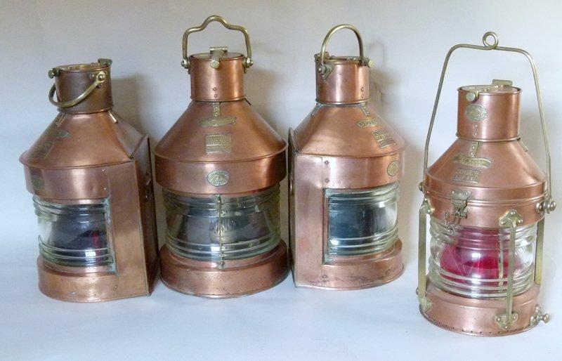 Four copper ships lamps.