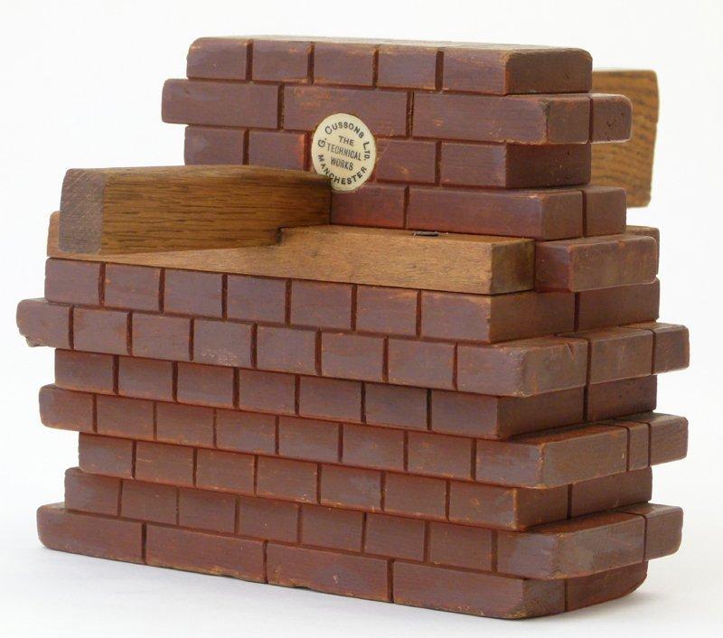 Wooden trade model brick and beam design.