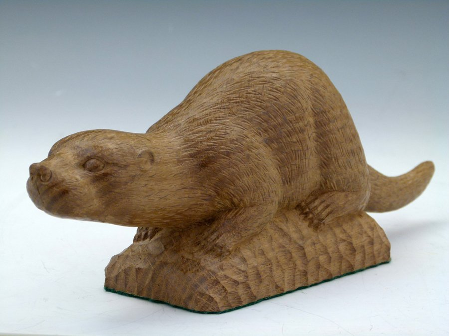 Carved oak study of a crouching otter by Stan Dodds,