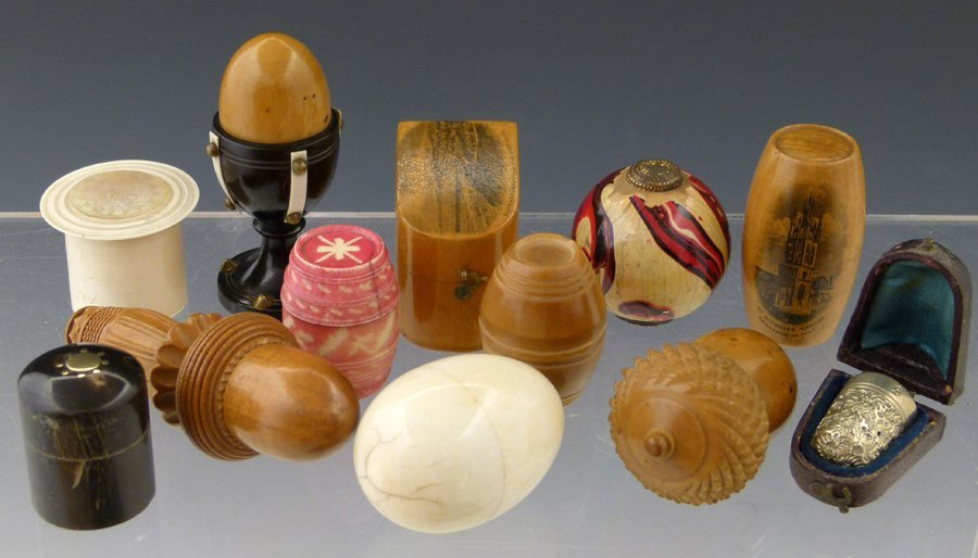 Collection of twelve assorted thimble cases in ivory,