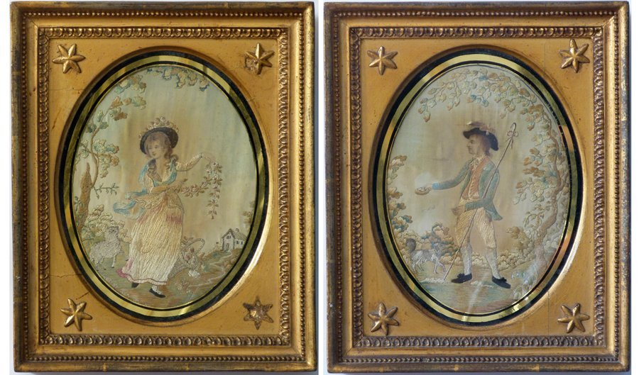 Pair of silk work and painted oval pastoral idyll