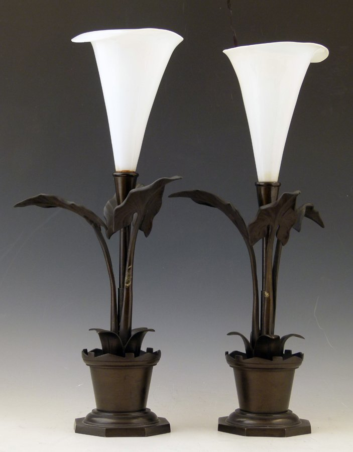 Pair of patinated bronze and white glass mantel