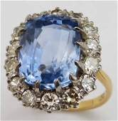 Sapphire and diamond cushion cluster ring, the central