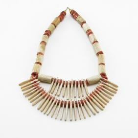 A Pre-Columbian Tayrona Red and White Coral Bead