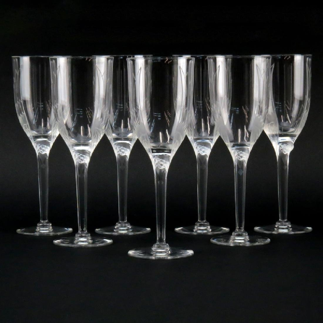 Seven (7) Lalique Crystal Ange/Angel Champagne Flutes.