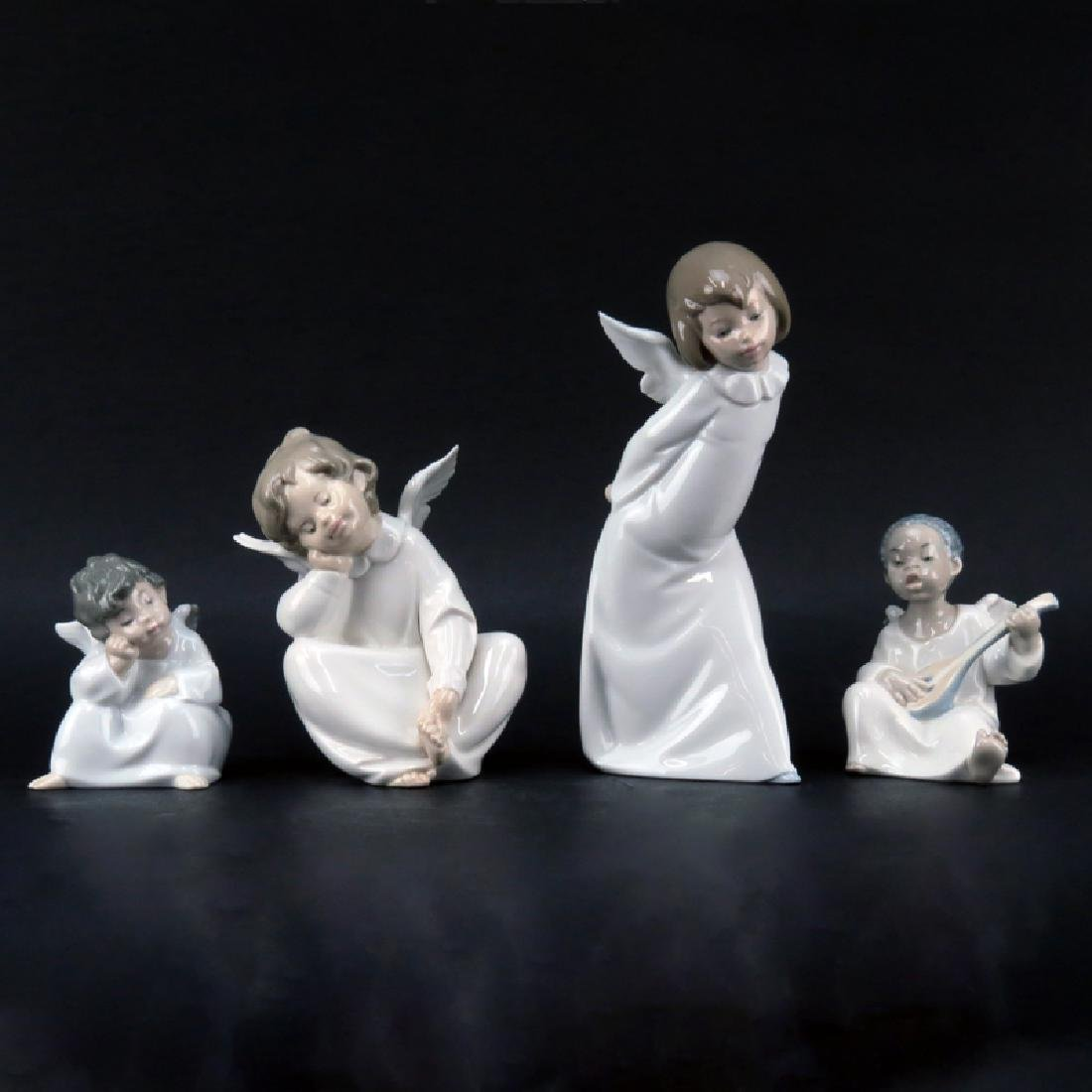 Grouping of Four (4) Lladro Glazed Porcelain Figurine.