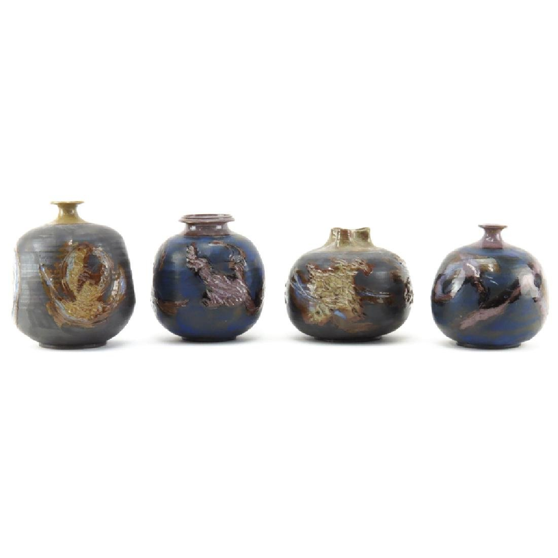 Grouping of Four (4) Terrin Levitt Ceramic Vases.