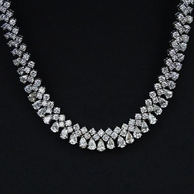 Approx. 37.0 Carat Pear Shape and Round Brilliant Cut