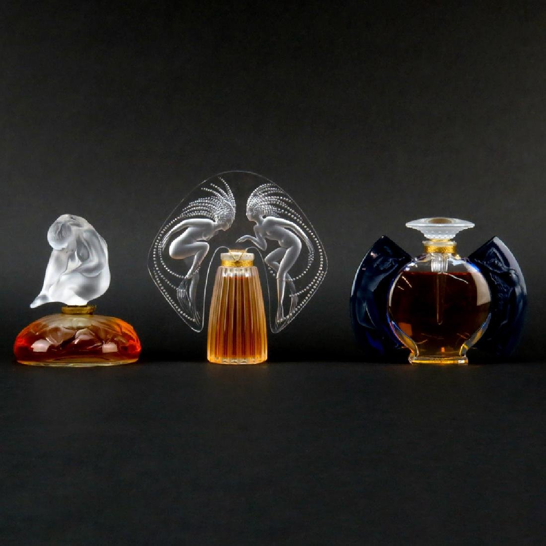 Three (3) Lalique Crystal Perfume Bottles. Includes
