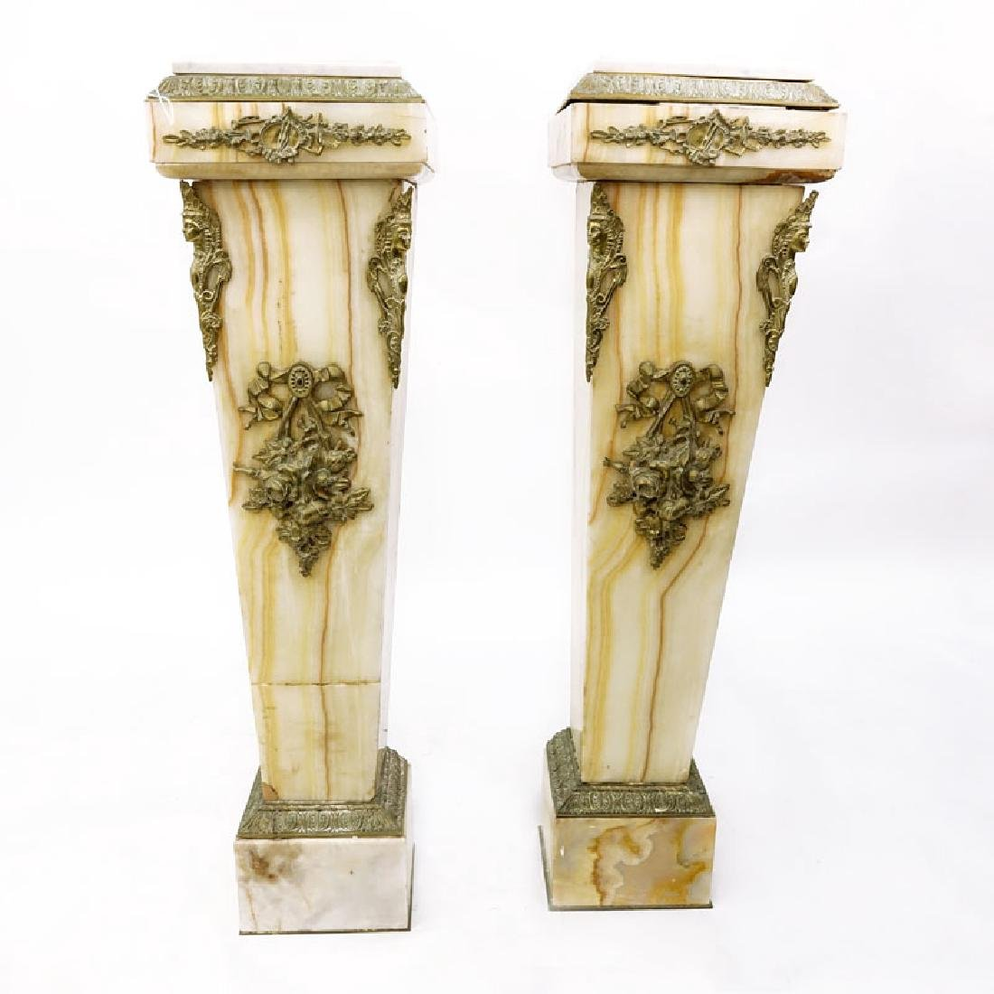 Pair of Antique Onyx Pedestal with Marble Tops. Bronze