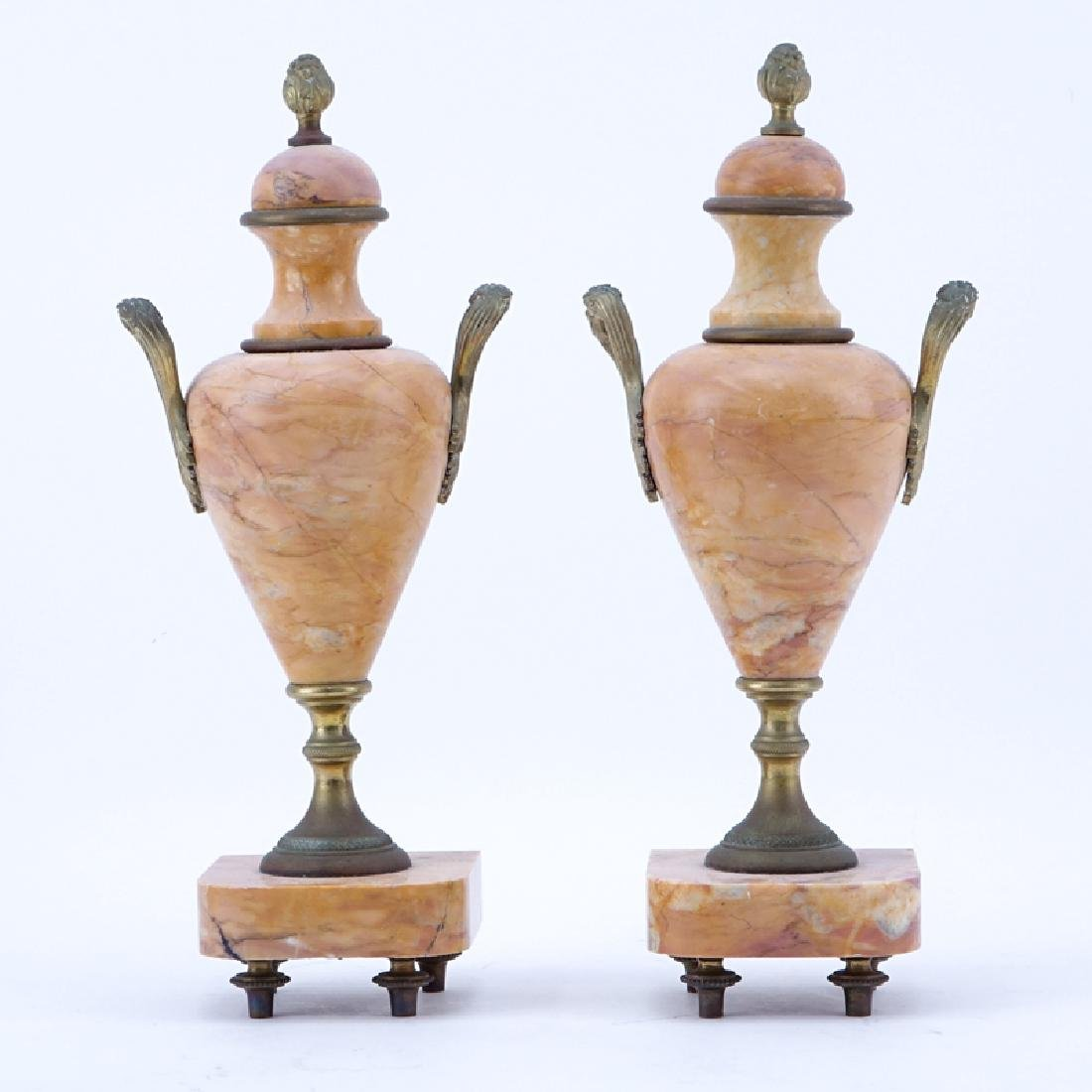 Pair of French Bronze Mounted Pink Marble Urns. Signed