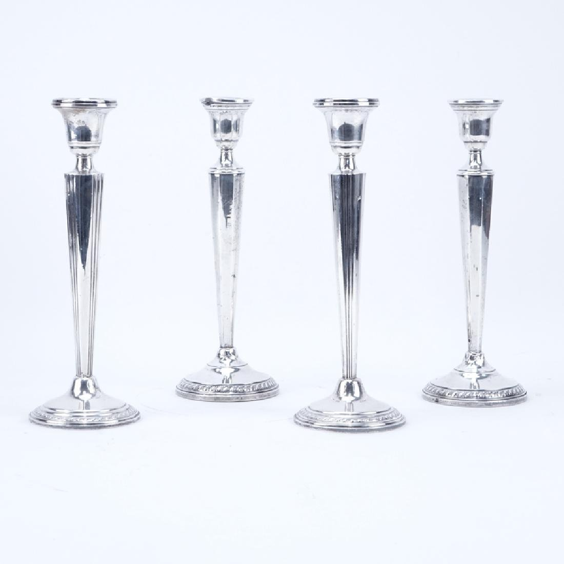 Two (2) Pair Weighted Sterling Silver Candlesticks.