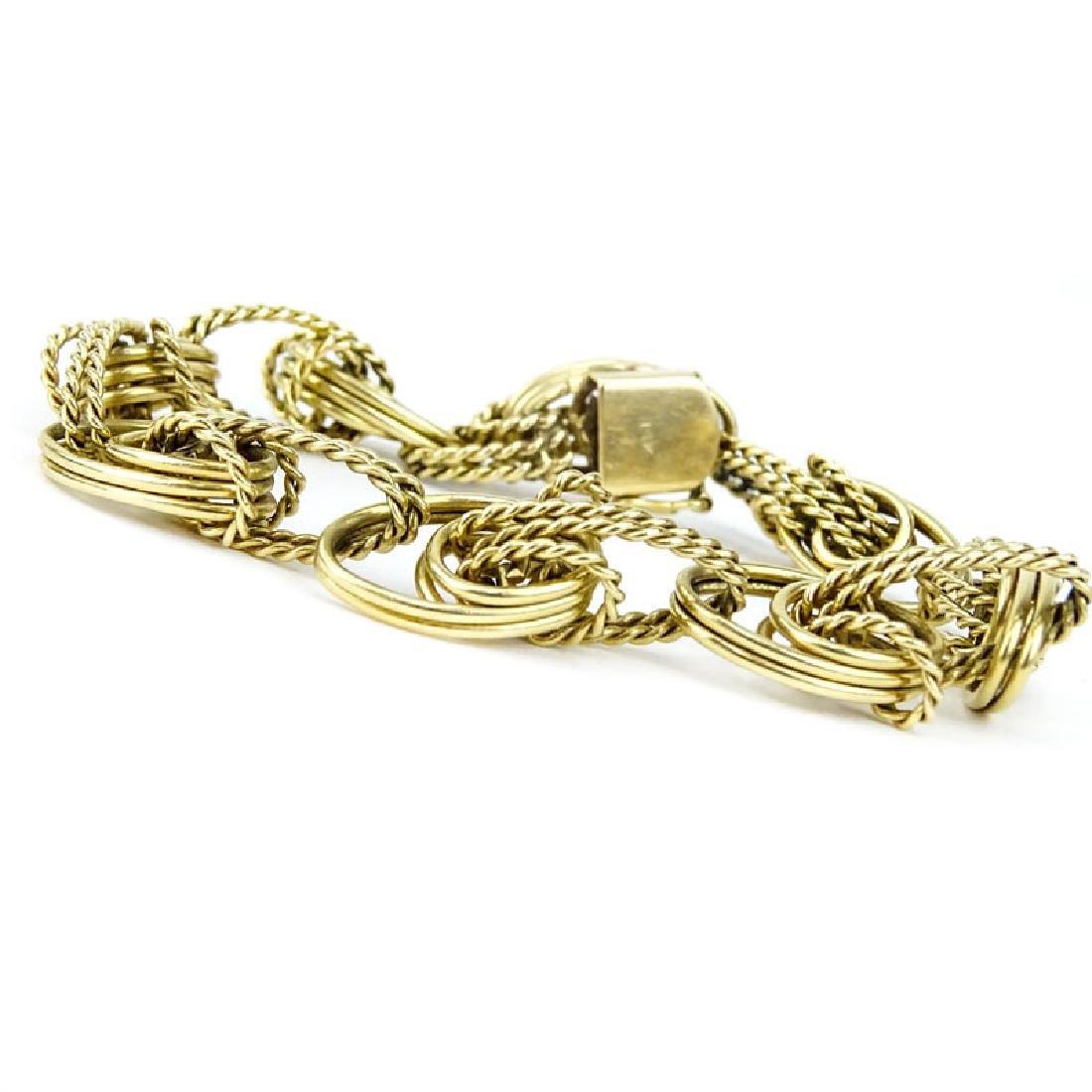 Vintage 14 Karat Yellow Gold Charm Bracelet. Signed