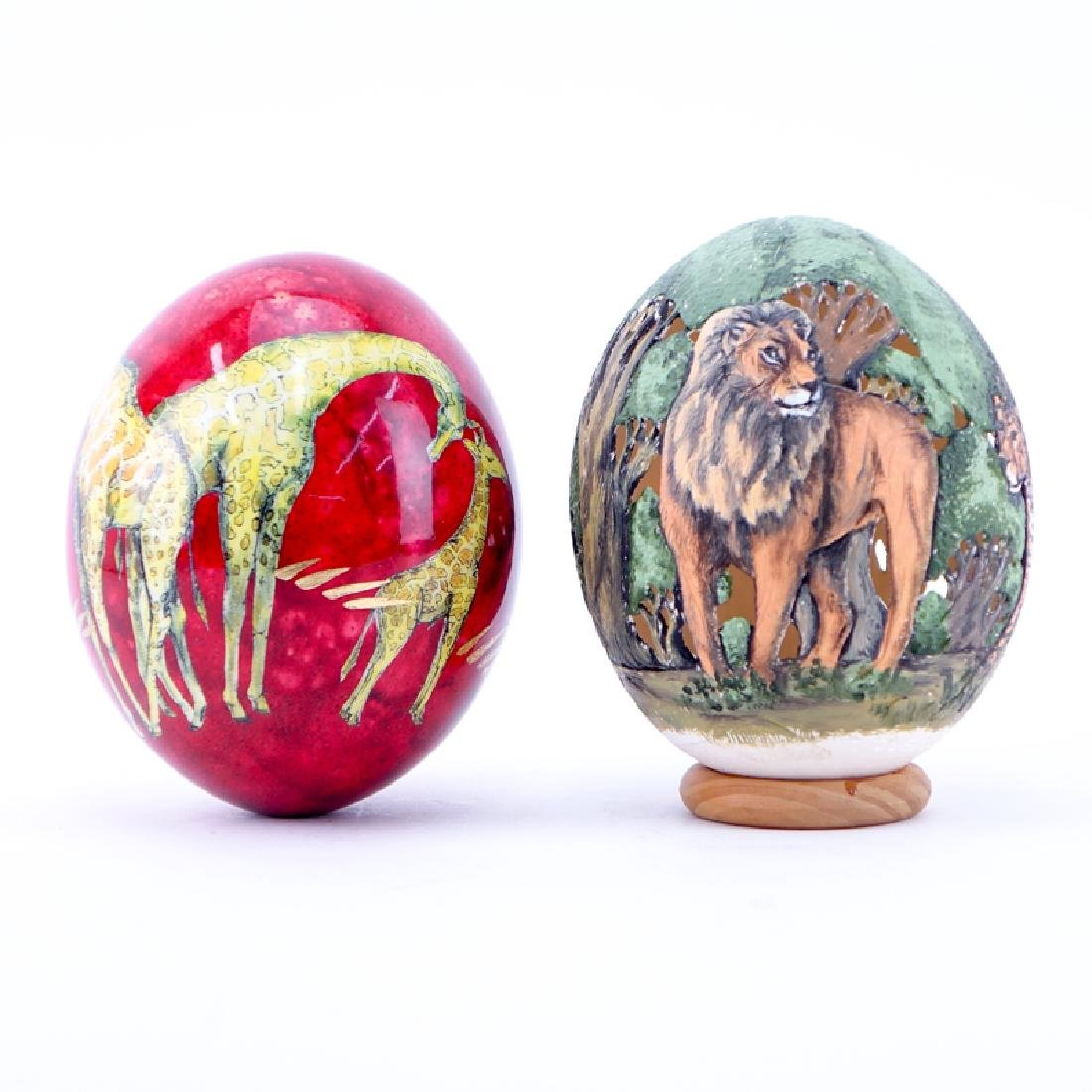 Grouping of Two (2) Painted Ostrich Eggs. One is signed