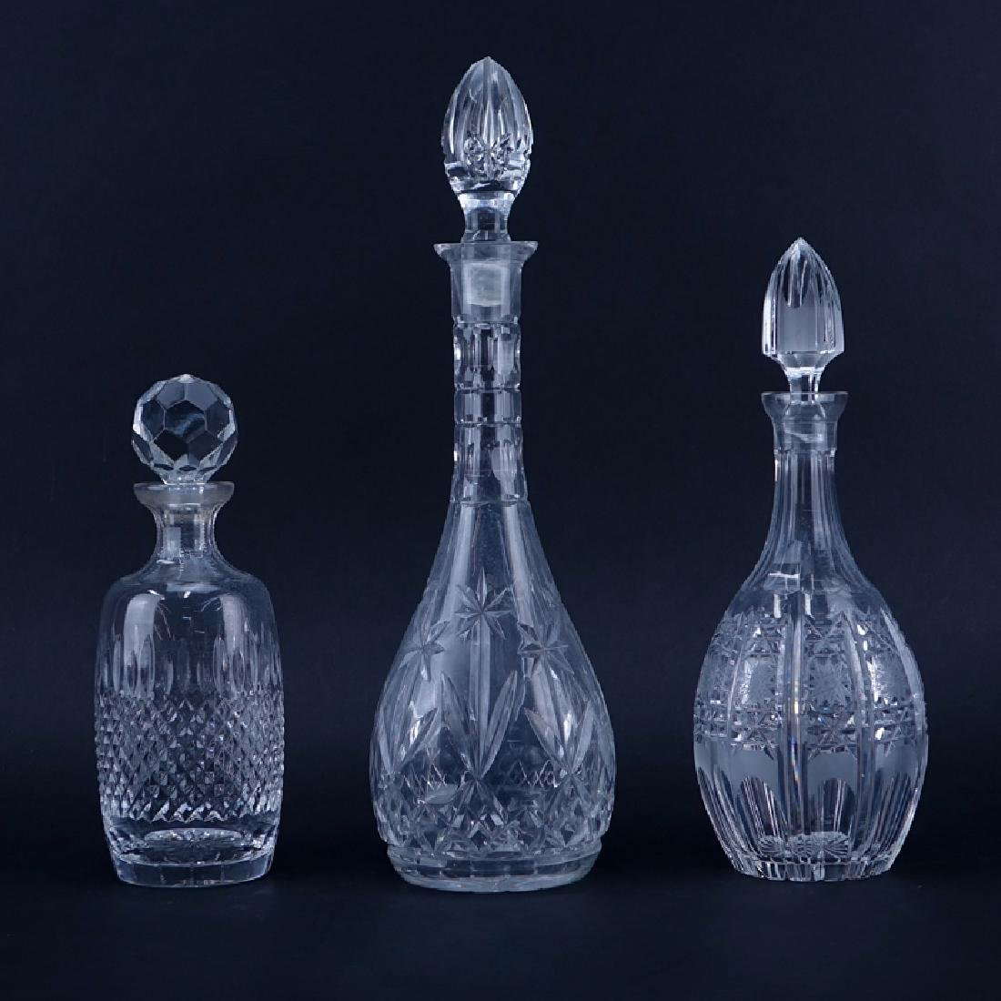 Three (3) Crystal Decanters. One signed Rogaska. Chips