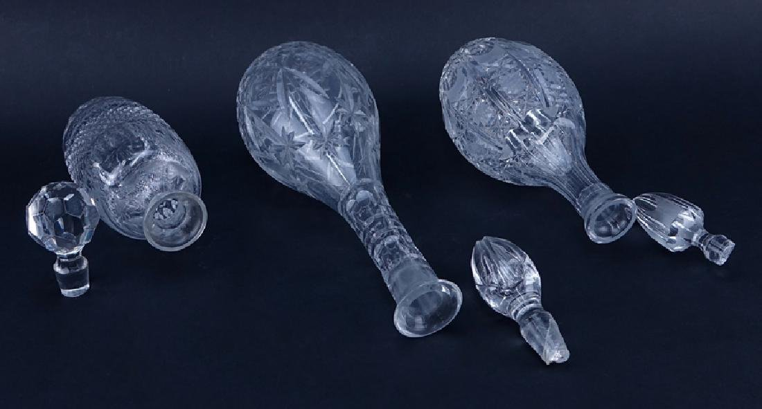 Three (3) Crystal Decanters. One signed Rogaska. Chips - 2