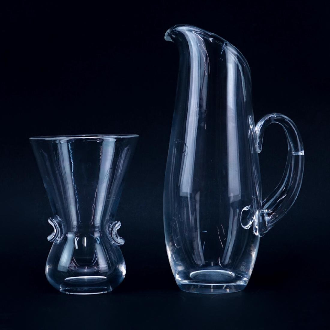 Two (2) Steuben Crystal Tableware. Includes: a carafe