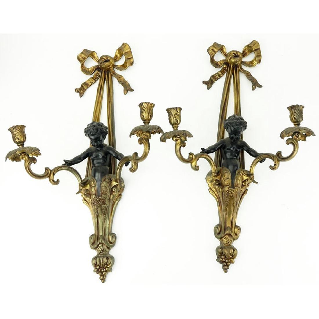Pair of Louis XVI Style Gilt Bronze Figural Sconces.
