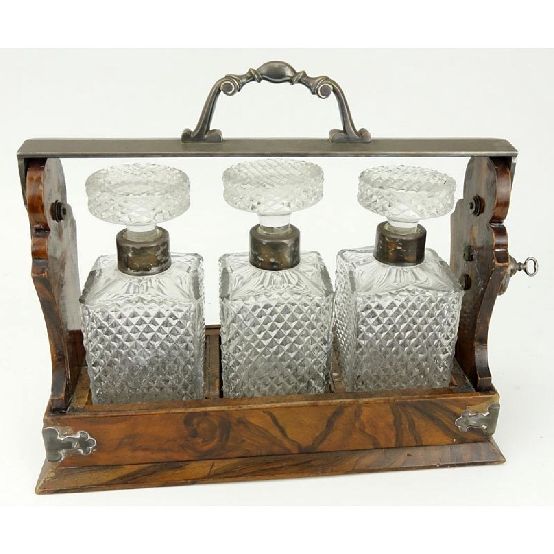 Betjemann's Patent Tantalus. 3 cut crystal decanters in
