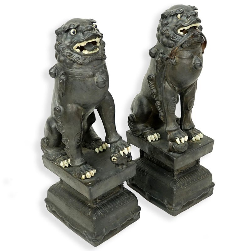 Pair of Modern Chinese Polychrome Pottery Foo Dogs.