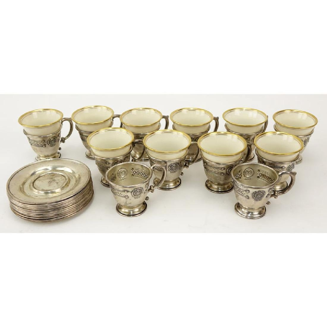 Set of Sterling and Porcelain Demitasse Cups and