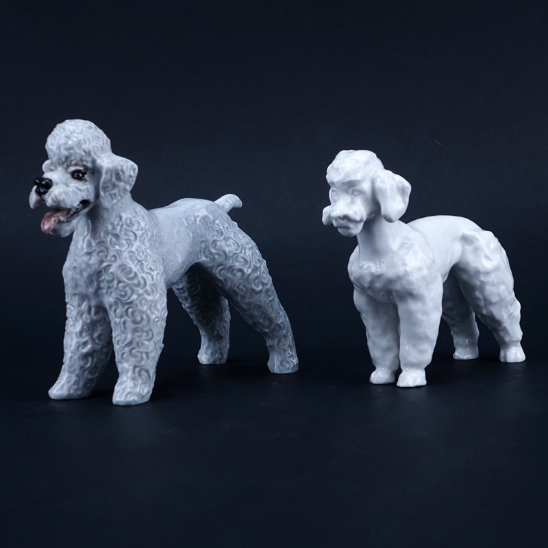 Two Porcelain Poodle Figurines. One signed with Meissen