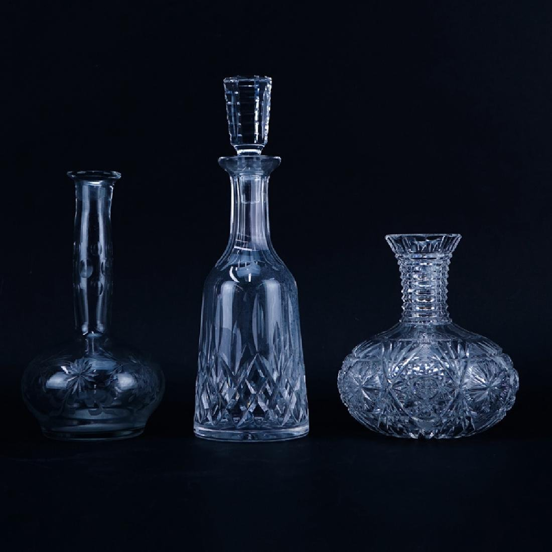 Lot of Three (3) Crystal Decanters. Includes a