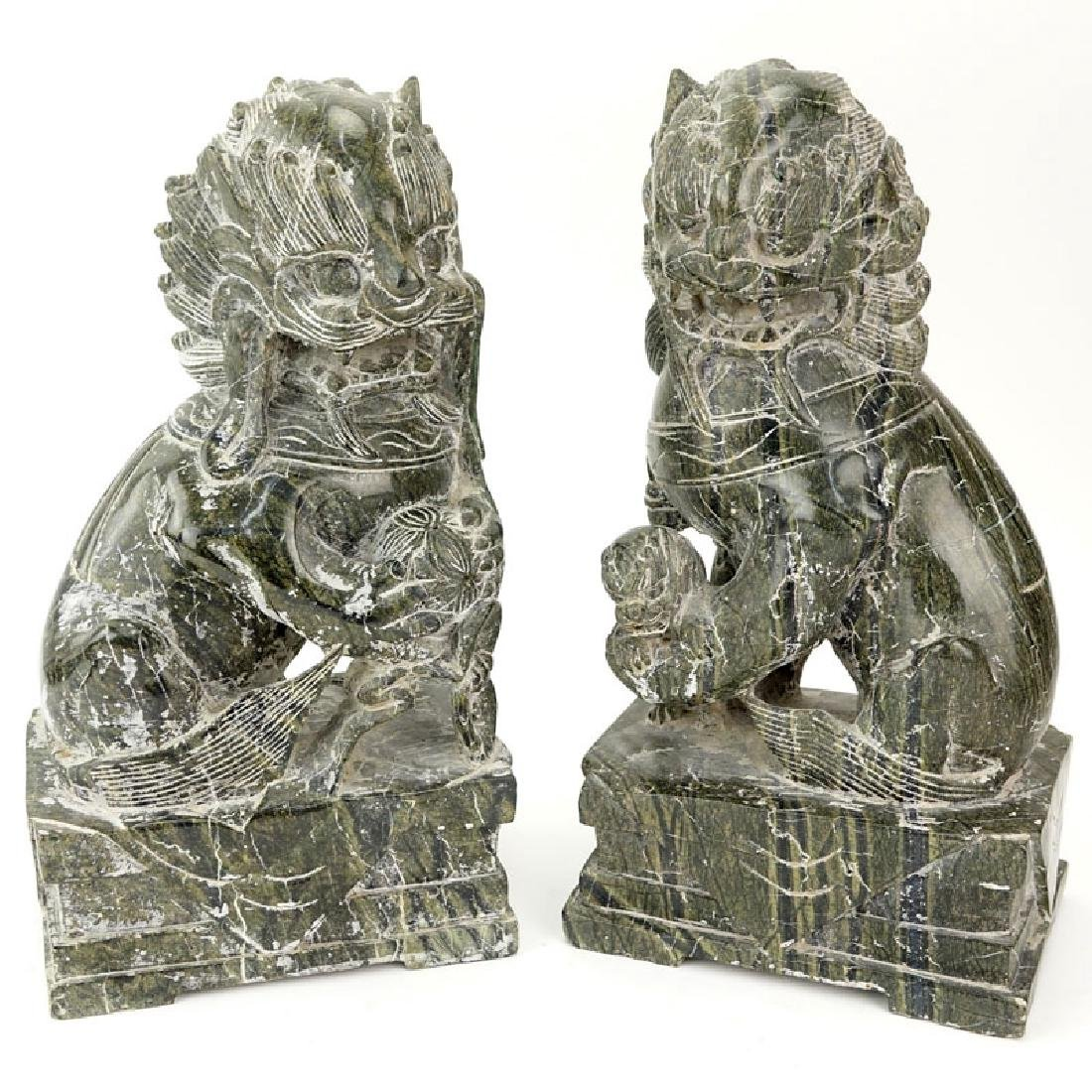 Pair Of 20th Century Chinese Carved Marble Foo Dogs.