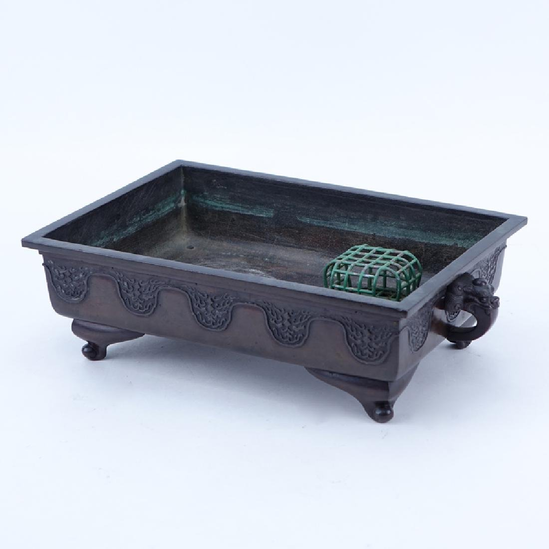Chinese Bronze Footed Planter With Figural Handles