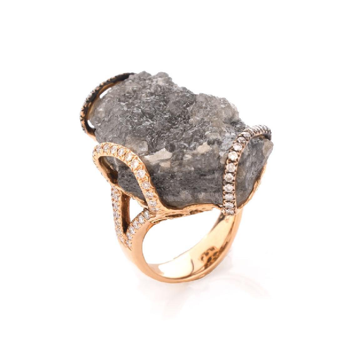 52.69 Carat Rough Diamond, .76 Carat Round Brilliant