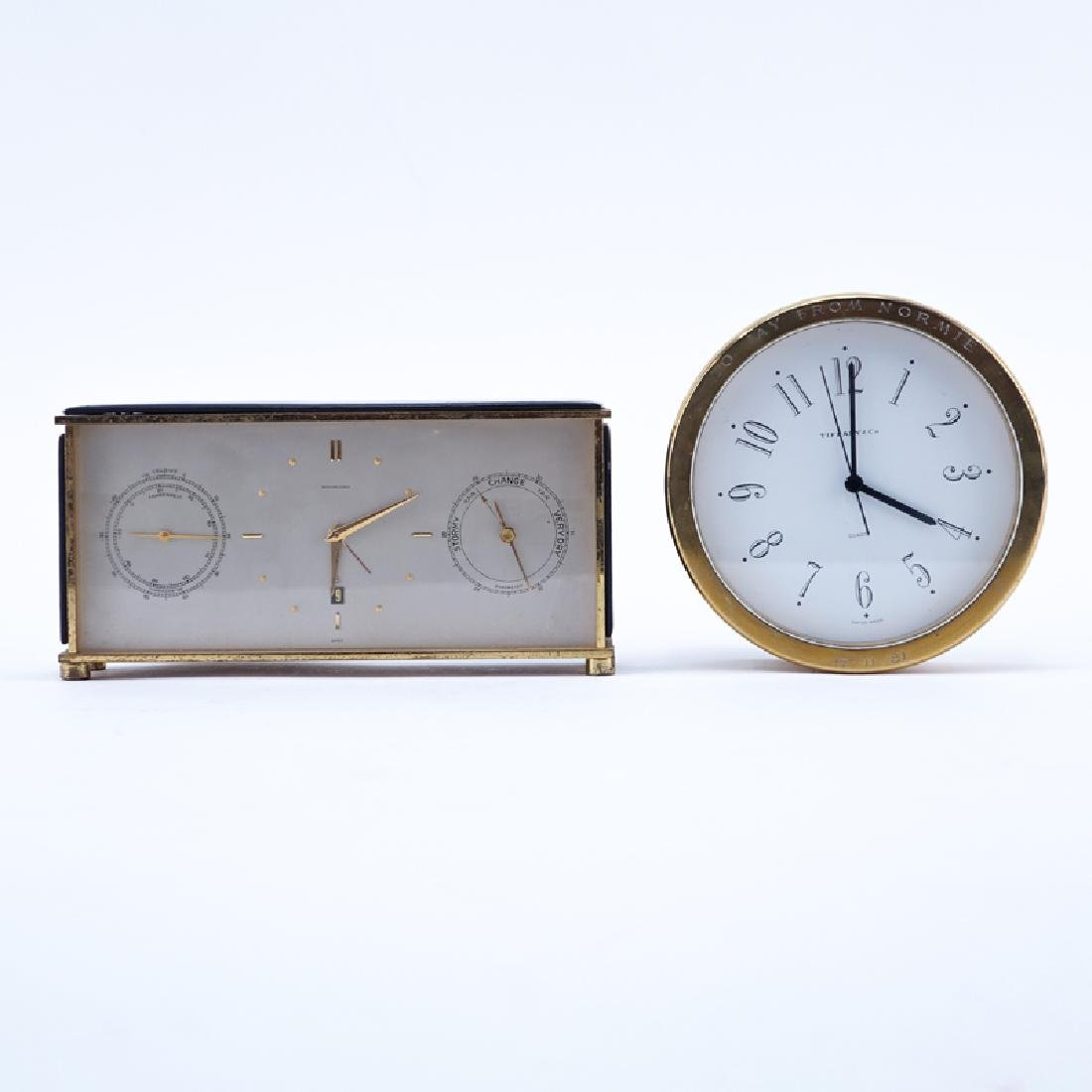 Two Brass Clocks. A Tiffany & Co. round quartz clock,