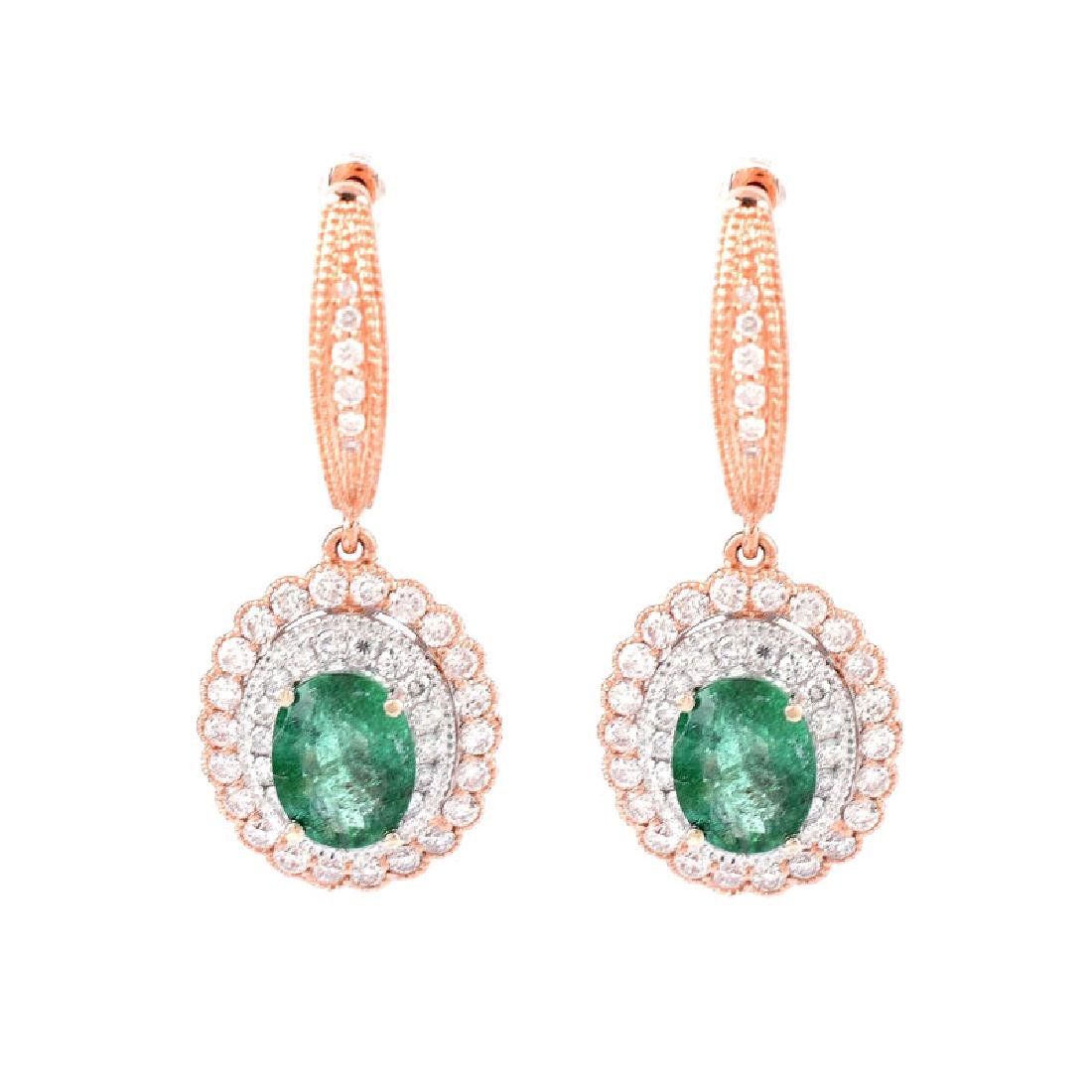 Pair of Oval Cut Colombian Emerald, Round Brilliant Cut