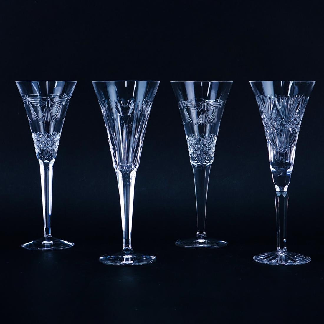 Four (4) Tall Waterford Crystal Champagne Flutes.
