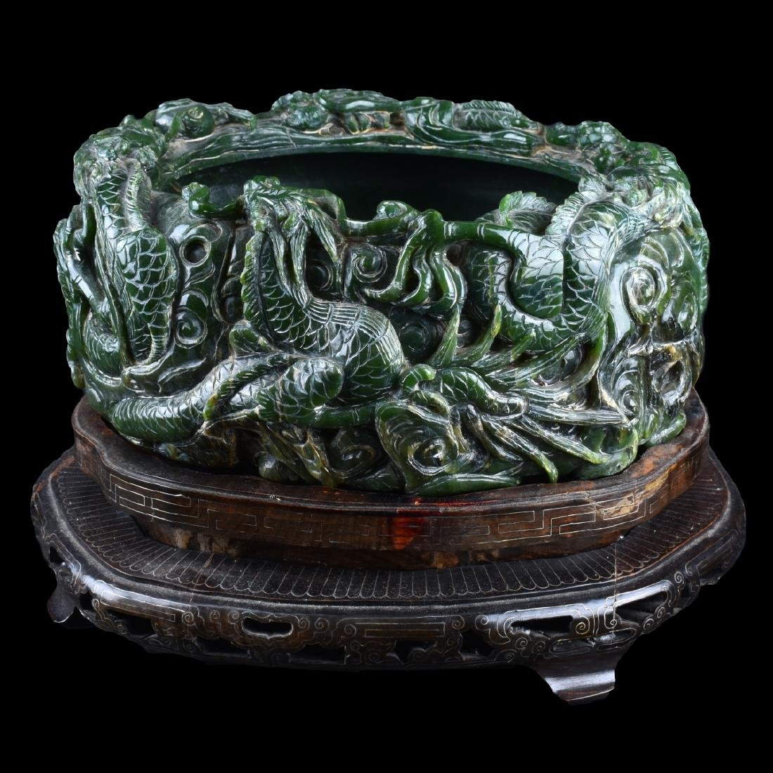 A Chinese Carved Spinach Jade Marriage Bowl