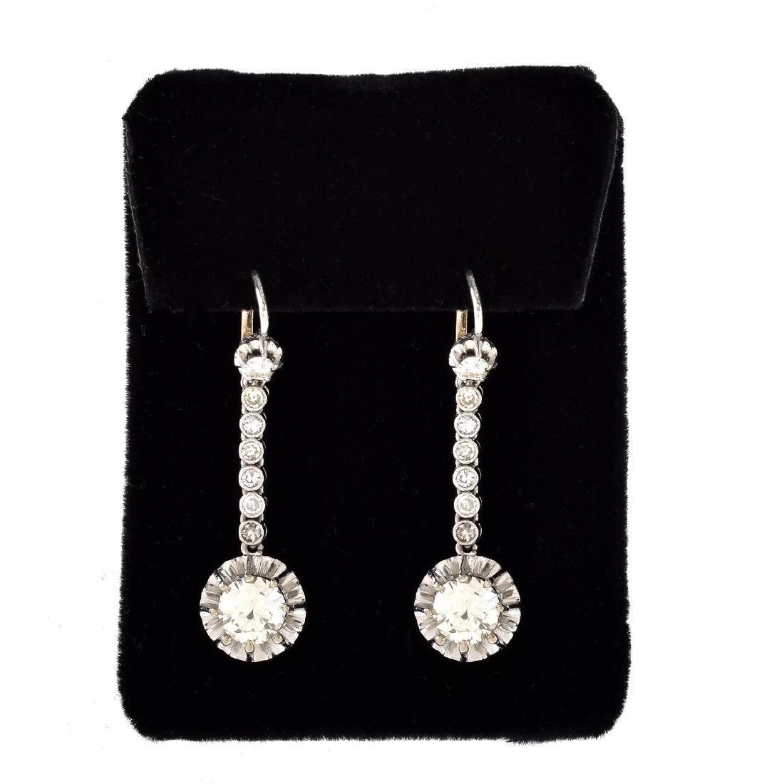 Diamond, Platinum and 14K Gold Earrings.