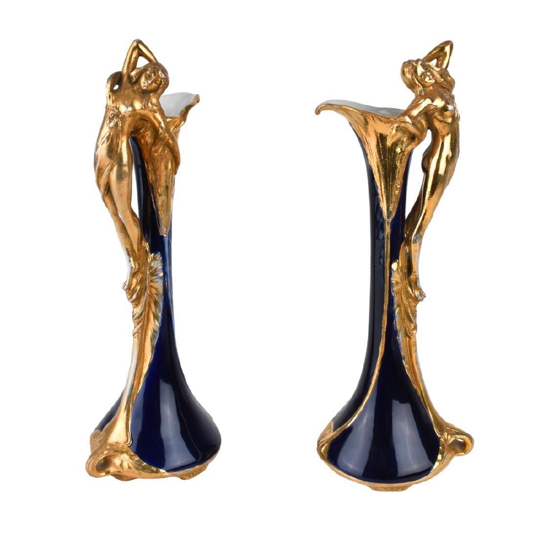 Pair of Amphora Cobalt Gilt Pottery Ewers