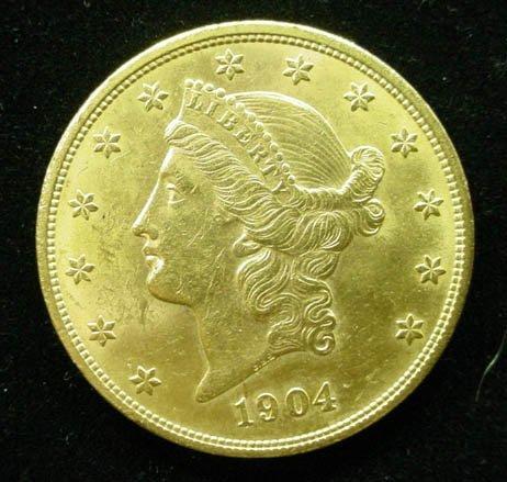 17: 1904 20 Dollar Double Eagle Gold Coin. Very Good Co
