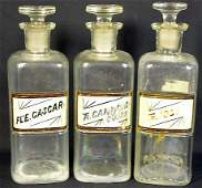 39: 3 Clear Glass Square Apothecary Bottles/Jars With L