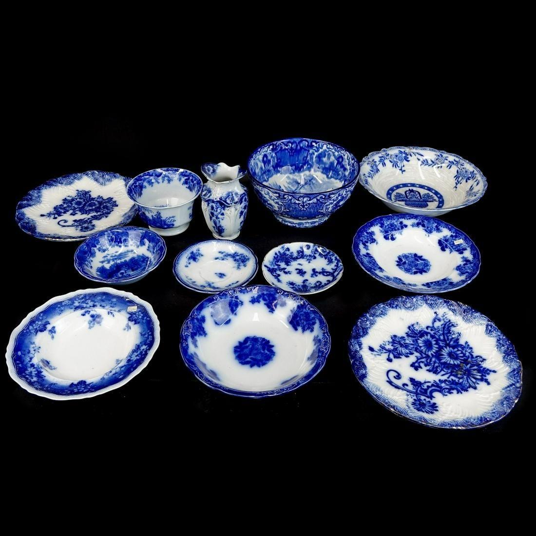 Twelve (12) Antique Flow Blue Tableware