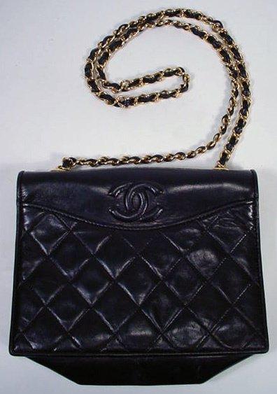 522: Black Chanel Hand Bag with Shoulder Strap. Signed