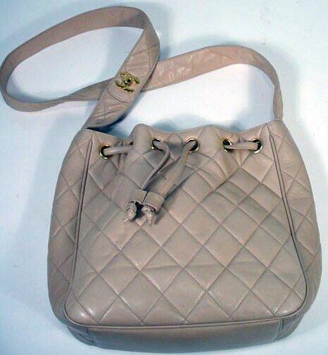 523: Beige Chanel Drawstring Hand Bag. Signed Chanel, H