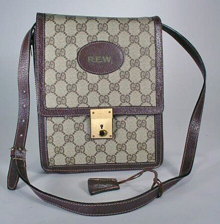 566: Brown Gucci Man Purse. Signed Gucci, Made in Italy